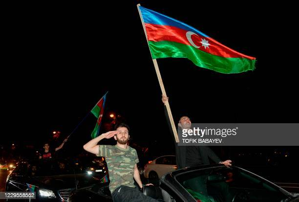 Azerbaijanis celebrate in the streets of Baku on November 10, 2020. - Armenia and Azerbaijan agreed on a deal with Russia to end weeks of fierce...
