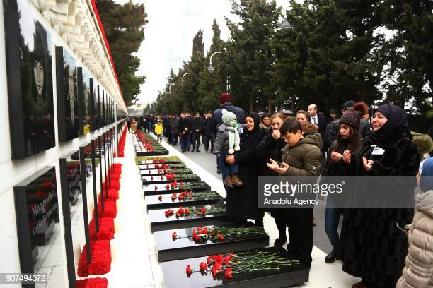 Azerbaijanis visit the Alley of Martyrs a cemetery and memorial dedicated to those killed by Soviet troops during the 1990 Black January crackdown in...