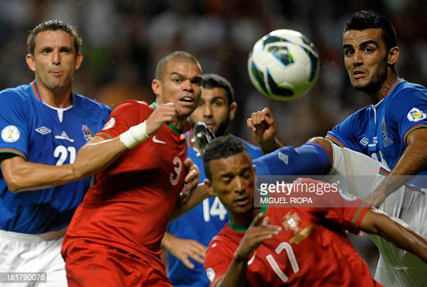Azerbaijan's defender Volodimir Levin Portuguese defender Pepe Portuguese midfielder Nani and Azerbaijan's defender Ruslan Abishov look at the ball...