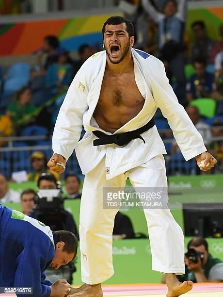 Azerbaijan's Elmar Gasimov celebrates after defeating Ukraine's Artem Bloshenko during their men's 100kg judo contest semifinal A match of the Rio...