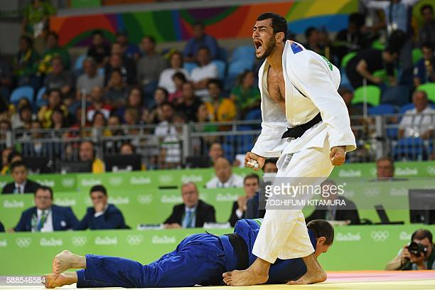 Azerbaijan's Elmar Gasimov celebrates after defeating Ukraine's Artem Bloshenko during their men's 100kg judo contest semifinal A match of the Rio...