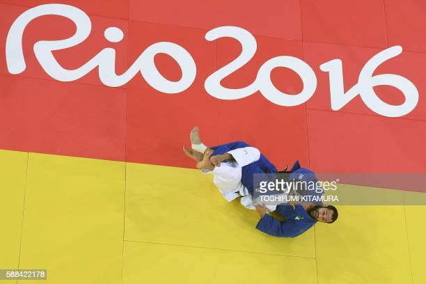 Azerbaijan's Elmar Gasimov competes with Algeria's Lyes Bouyacoub during their men's 100kg judo contest match of the Rio 2016 Olympic Games in Rio de...