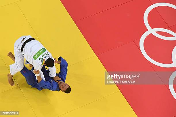 Azerbaijan's Elmar Gasimov competes with Czech Republic's Lukas Krpalek during their men's 100kg judo contest gold medal match of the Rio 2016...