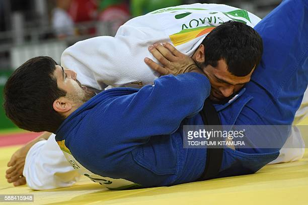Azerbaijan's Elmar Gasimov competes with Russia's Tagir Khaibulaev during their men's 100kg judo contest match of the Rio 2016 Olympic Games in Rio...