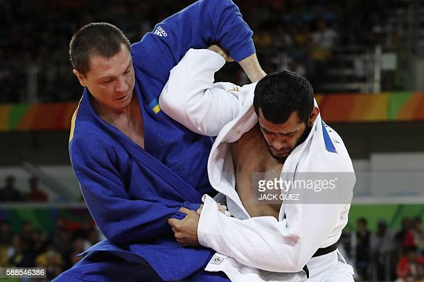 Azerbaijan's Elmar Gasimov competes with Ukraine's Artem Bloshenko during their men's 100kg judo contest semifinal A match of the Rio 2016 Olympic...