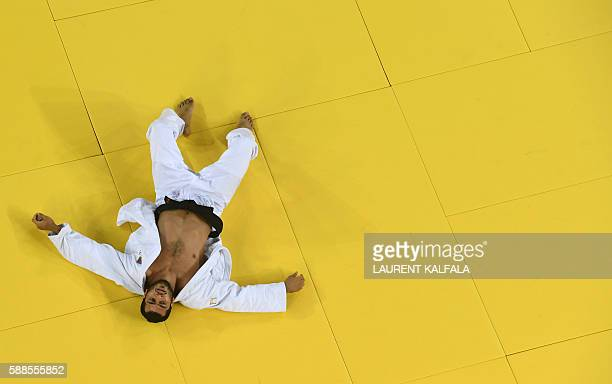 Azerbaijan's Elmar Gasimov reacts after losing to Czech Republic's Lukas Krpalek during their men's 100kg judo contest gold medal match of the Rio...