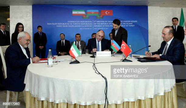 Azerbaijan's Foreign Minister Elmar Mammadyarov and his Iranian and Turkish counterparts Mohammad Javad Zarif and Mevlut Cavusoglu hold a meeting in...