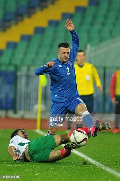 Azerbaijan's Gara Garayev vies for the ball with Ivelin Popov during the EURO 2016 Group H match between Bulgaria and Azerbaijan at Vassil Levski...