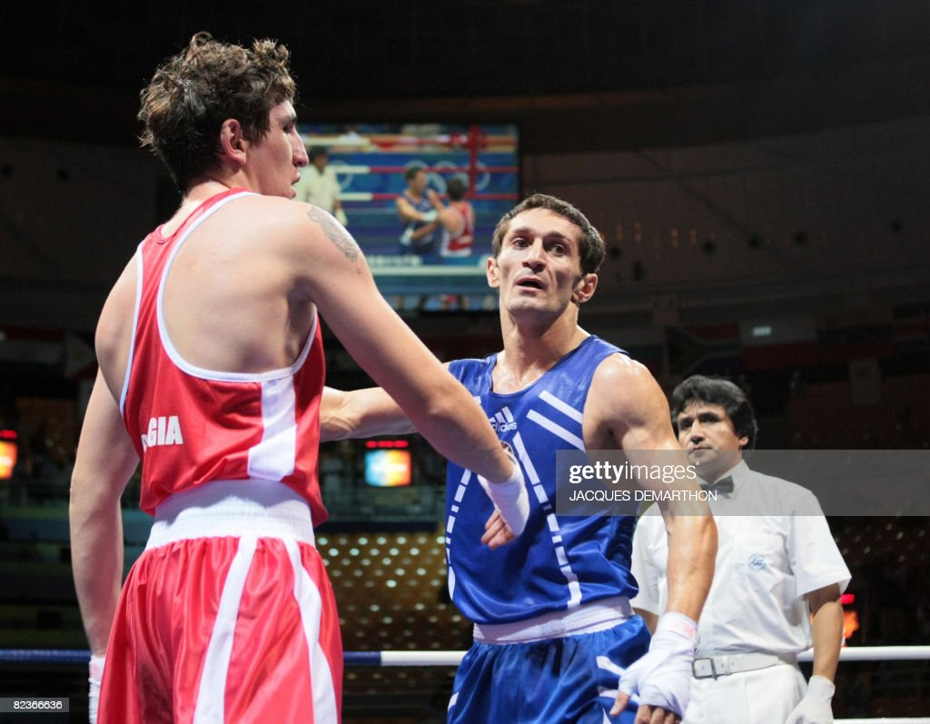 Azerbaijan's Imranov Shahin (BLUE) is declared winner after defeating Georgia's Nikoloz Izoria during their 2008 Olympic Games Featherweight (57 kg) boxing bout on August 15, 2008 in Beijing.