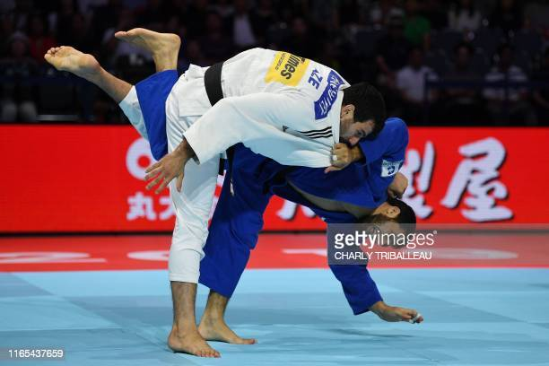 Azerbaijan's Mammadali Mehdiyev fights against Russia's Khasan Khalmurzaev in the men's under 90kg category during the fight for the bronze medal of...