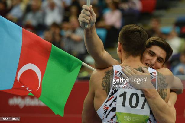 Azerbaijan's Murad Agharzayev and Bence Talas celebrate their win in the Men's Horizontal Bar final in Artistic Gymnastics during day four of Baku...