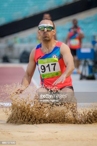 Azerbaijan's Muradov Elchin competes during the Men's Long Jump T11of the Athletics events at the Baku 2017 4th Islamic Solidarity Games at the...