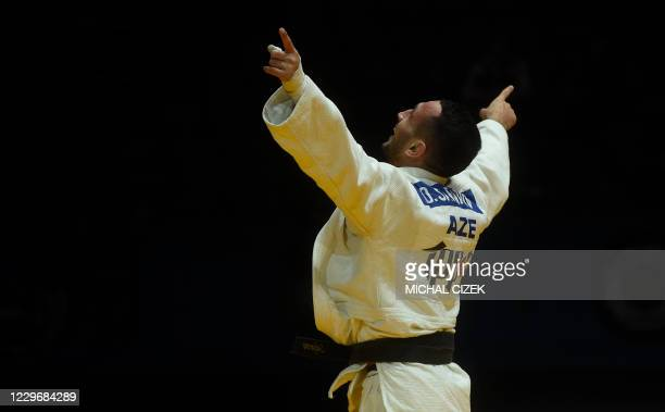 Azerbaijan's Orkhan Safarov celebrates after defeating Israel's Tal Flicker at the men's under 66kg weight category final match at the European Judo...