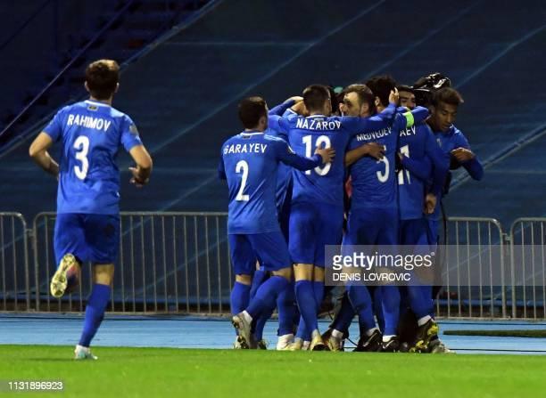 Azerbaijan's players celebrate after scoring during the Euro 2020 qualification football match between Croatia and Azerbaijan at Maksimir stadium in...