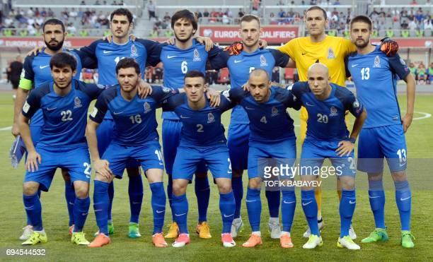 Azerbaijan's players Rashad Sadygov Ramil Sheidaev Badavi Guseynov Maksim Medvedev goalkeeper Kamran Aghayev and Dmitrij Nazarov Afran Ismailov Javid...