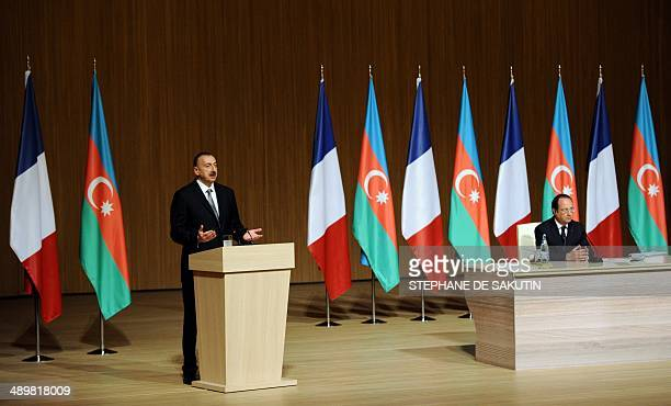 Azerbaijan's President Ilham Aliyev gives a speech as France's President Francois Hollande listens him during the final cession of the...