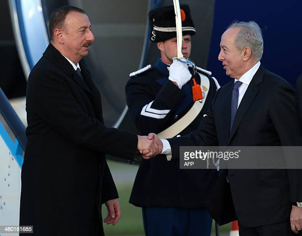 Azerbaijan's President Ilham Aliyev is greeted by an official upon his arrival at Schiphol airport in Amsterdam on March 23 2014 ahead of the March...