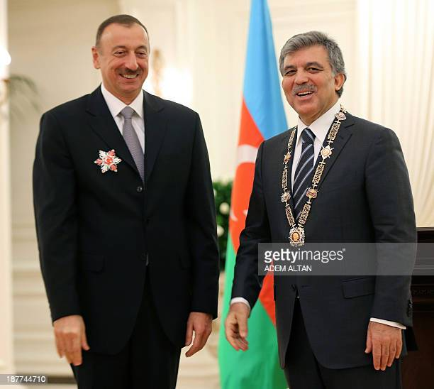 Azerbaijan's president Ilham Aliyev poses next to Turkey's president Abdullah Gul after being awarded with Order of the Republic Medal of Turkey the...
