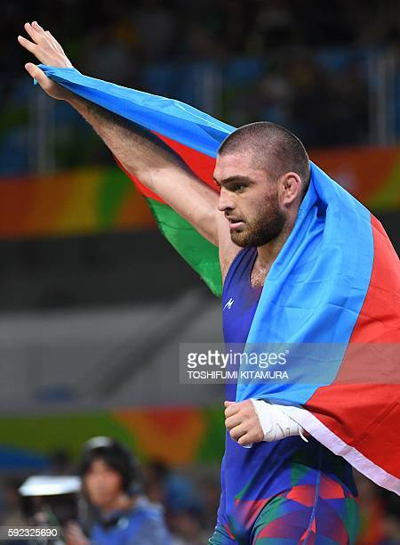 Azerbaijan's Sharif Sharifov celebrates after winning against Venezuela's Pedro Francisco Ceballos Fuentes in their men's 86kg freestyle bronze medal...