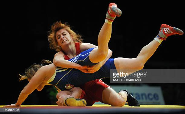 Azerbaijan's Sona Ahmadli fights with Bulgaria's Nadzeya Mikhalkova during the 59 kg freestyle woman third place final of the European Wrestling...