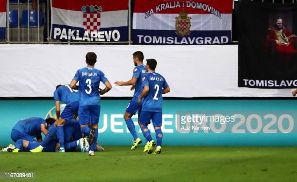 Azerbaijan's Tamkin Khalilzade celebrates scoring their first goal with during UEFA Euro 2020 Group E Qualifier match match between Azerbaijan and...