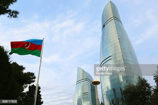 Azerbajan flag fire and Flame towers complex in the background