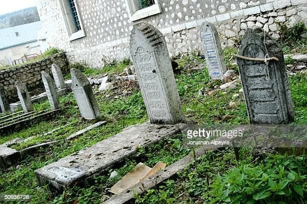 Azeri graves rest next to the mosque in the town of Shushi May 4, 2004 Nagorno-Karabakh, Azerbaijan. The Karabastis never touched or destroyed Muslim...