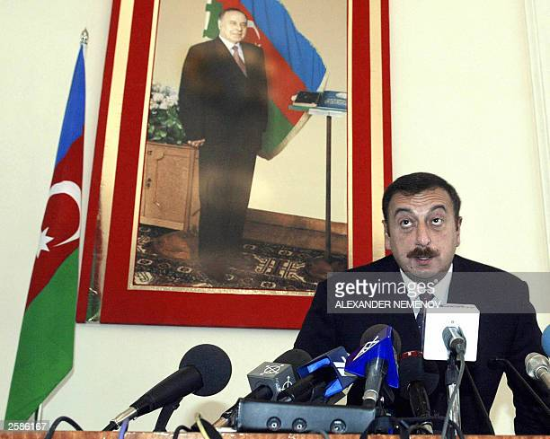 Azeri presidential candidate Prime Minister Ilkham Aliyev the son of current President Heidar Aliyev takes his seat in front of his father''s...
