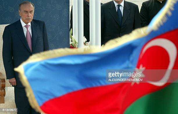 Azeri Prezident Heidar Aliyev looks on waiting for Pope's John Paul II arrival in Baku airport 22 May 2002 with the national flag in foregrounds Pope...