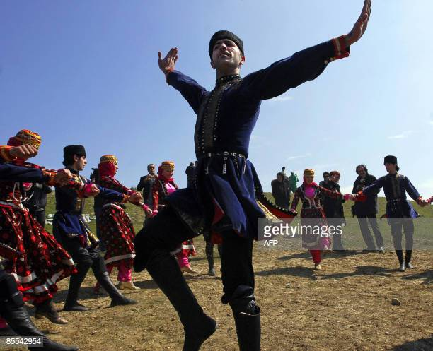 Azeris in traditinal dress dance outside Baku on March 21 2009 during the annual Nowruz holiday Nowruz which means new day in Kurdish and marks the...