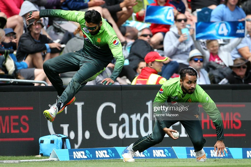 Azhar Ali (L) and Faheem Ashraf of Pakistan avoid colliding when fielding during the third game of the One Day International Series between New Zealand and Pakistan at University of Otago Oval on January 13, 2018 in Dunedin, New Zealand.