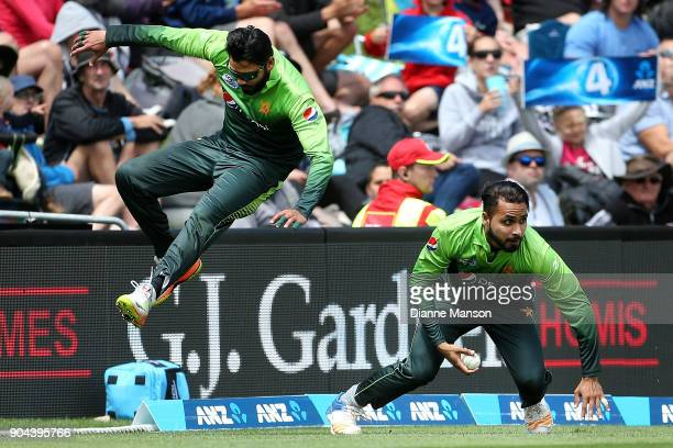 Azhar Ali and Faheem Ashraf of Pakistan avoid colliding when fielding during the third game of the One Day International Series between New Zealand...