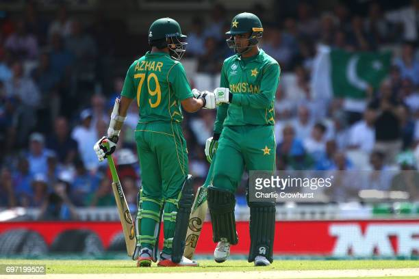 Azhar Ali and Fakhar Zaman of Pakistan chat in the middle during the ICC Champions Trophy Final match between India and Pakistan at The Kia Oval on...