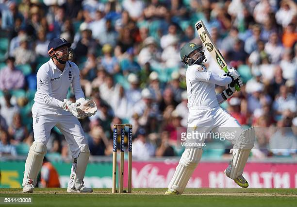 Azhar Ali hits Moeen Ali of England for six to win the match for Pakistan as Jonny Bairstow looks on during day four of the fourth Investec test...
