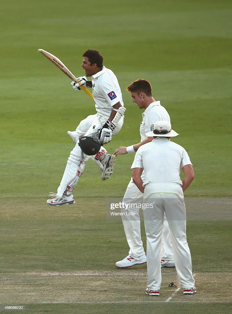 Azhar Ali of Pakistan celebrates reaching his century during day one of the second test between Pakistan and Australia at Sheikh Zayed stadium on October 30, 2014 in Abu Dhabi, United Arab Emirates.