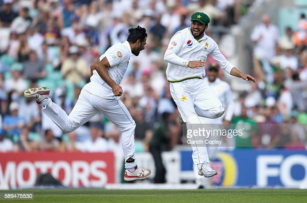 Azhar Ali of Pakistan celebrates with Wahab Riaz after catching out Jonathan Bairstow of England during day four of the 4th Investec Test between...