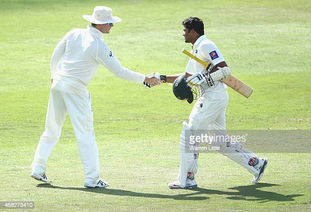 Azhar Ali of Pakistan is congratulated by Michael Clarke Australian Captain after reaching his century during Day Four of the Second Test between...