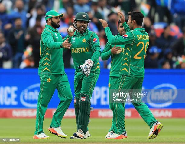 Azhar Ali of Pakistan is congratulated on catching Shikar Darwan of India during the ICC Champions Trophy match between India and Pakistan at...