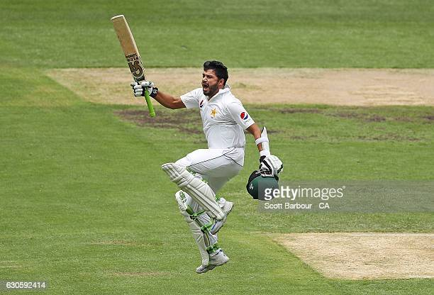 Azhar Ali of Pakistan leaps in the air as he celebrates reaching 200 runs during day three of the Second Test match between Australia and Pakistan at...