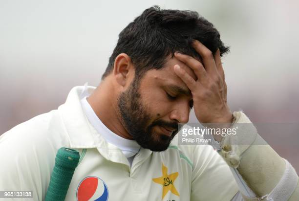 Azhar Ali of Pakistan leaves the field after being dismissed during the 2nd Natwest Test match between England and Pakistan at Headingley cricket...