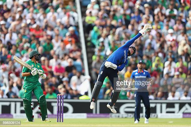 Azhar Ali of Pakistan looks on as wicketkeeper Jonny Bairstow leaps high in an attempt to stop a high no ball delivery from Moeen Ali during the 4th...