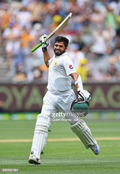 Azhar Ali of Pakistan raises his bat after reaching 200 runs during day three of the Second Test match between Australia and Pakistan at Melbourne...