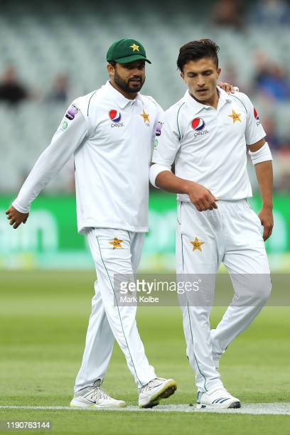 Azhar Ali of Pakistan speaks to Muhammad Musa of Pakistan between balls during day one of the 2nd Domain Test between Australia and Pakistan at...