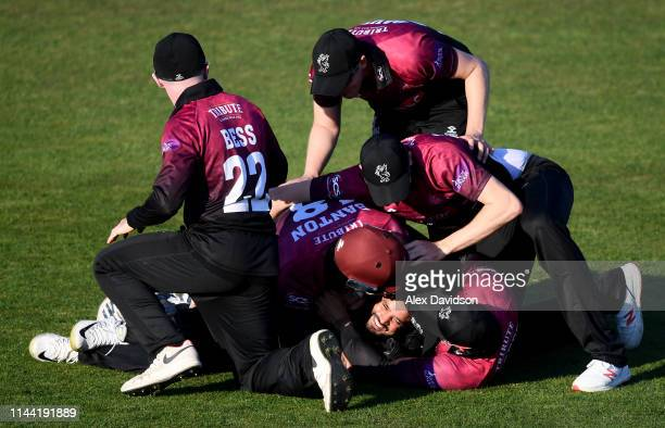 Azhar Ali of Somerset is mobbed by his teammates after taking the catch of Lukas Carey to win the game during the Royal London One Day Cup match...