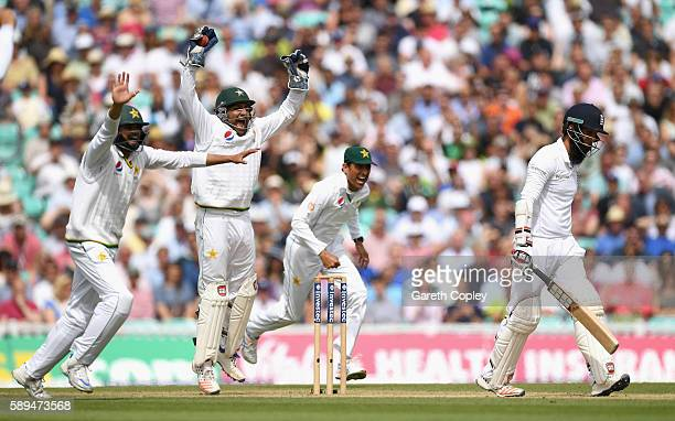 Azhar Ali, Sarfraz Ahmed and Younis Khan of Pakistan celebrate the wicket of Moeen Ali of England during day four of the 4th Investec Test between...