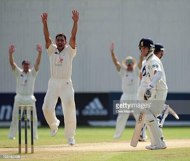 Azhar Mahmood of Kent celebrates dismissing Laurie Evans of Warwickshire during the LV County Championship match between Warwickshire and Kent at...