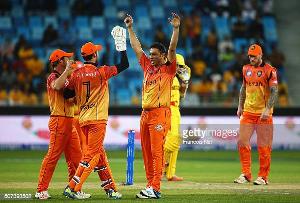 Azhar Mahmood of Virgo Super Kings celebrates taking the wicket of Adam Gilchrist of Sagittarius Strikers during the Oxigen Masters Champions League...