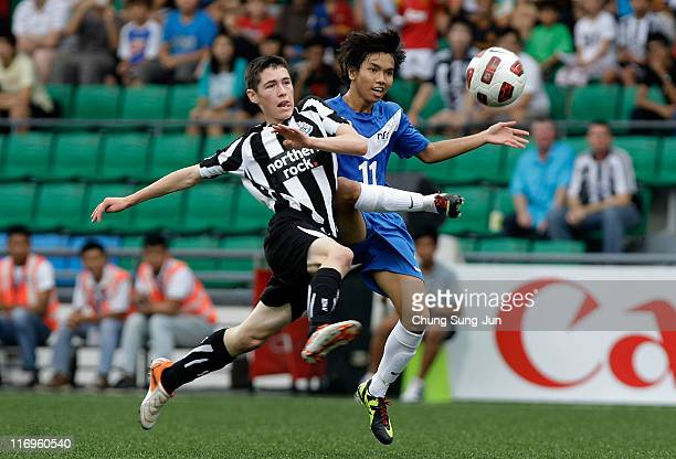 Azhar Ramil of Singapore U15 and Ben Drennan of Newcastle United FC compete for the ball during the 2011 Canon Lion City Cup match between Singapore...