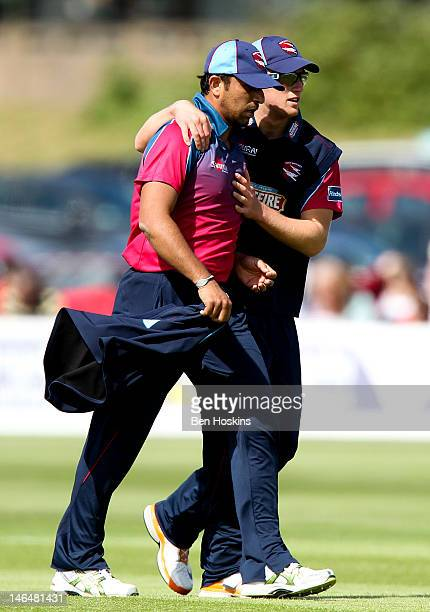 Azhar Sagar of Kent is congratulated by Mark WIlson of Kent after taking 2 wickets during the Friends Life T20 match between Kent and Surrey at The...