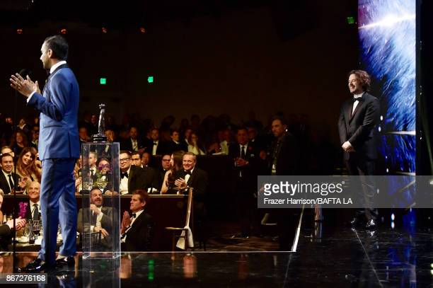 Aziz Ansari accepts the Charlie Chaplin Britannia Award for Excellence in Comedy presented by Jaguar Land Rover from Edgar Wright at the 2017 AMD...